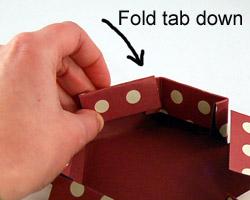 glue the tab down